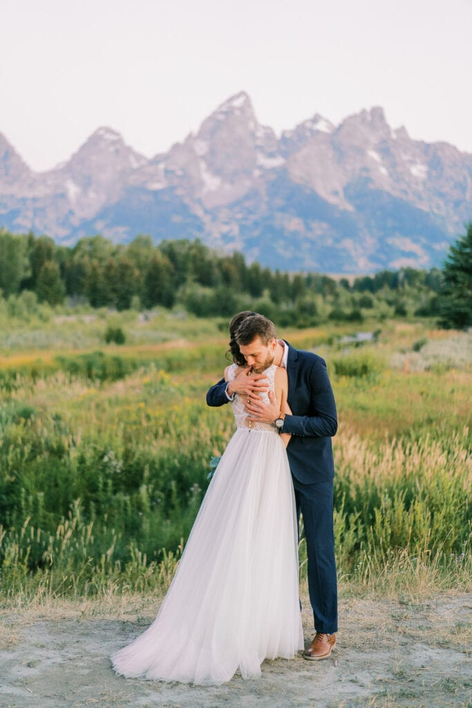 Bride and groom hug during an elopement in Grand Teton National Park.