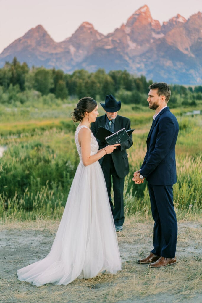 Bride reads personal vows at a ceremony in Grand Teton National Park.