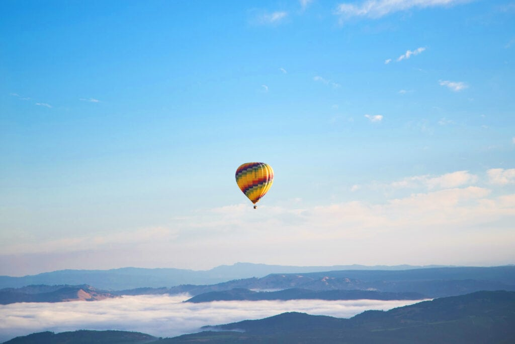 Hot air balloon elopement in the mountains.