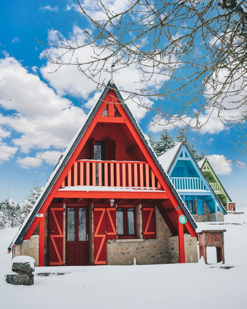 Real estate photography in Colorado of some A-frame cabins during winter with snow.