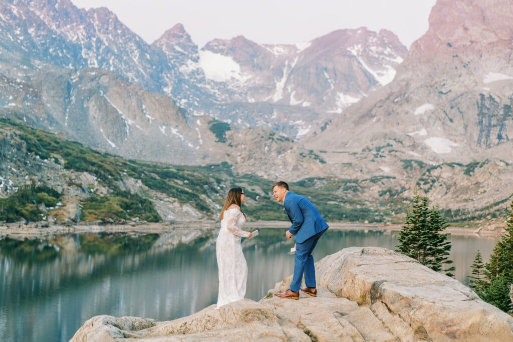 Bride and groom laugh during funny vows during an elopement in Boulder, Colorado in the Indian Peaks Wilderness.