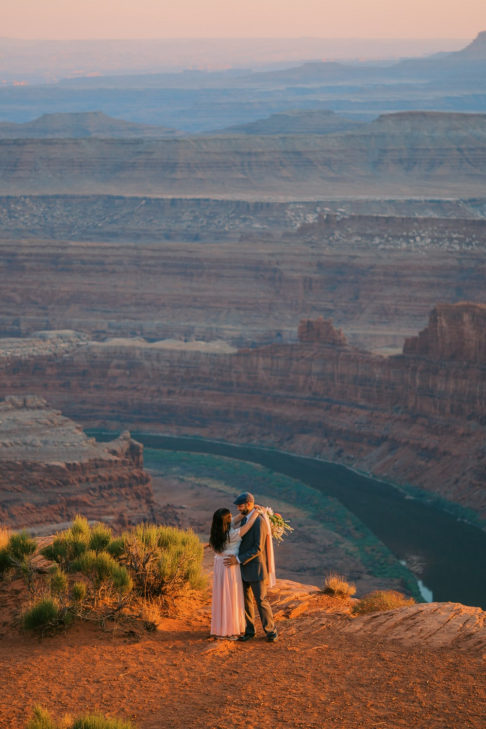Bride and groom saying vows at their Dead Horse Point State Park elopement in Moab, Utah.