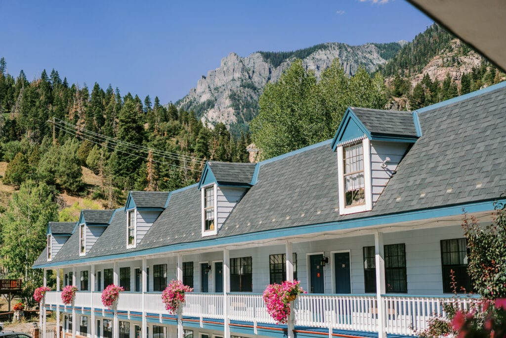 Twin Peaks Lodge in Ouray, Colorado during summer with blooming pots of flowers.