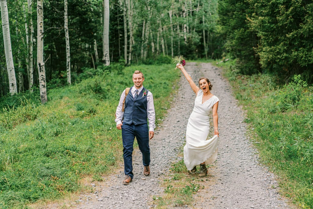 Bride and groom walk into their wedding in the mountains of Ouray, Colorado.