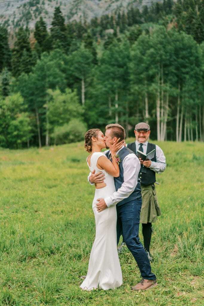 Bride and groom's first kiss during their Ouray wedding in Colorado.