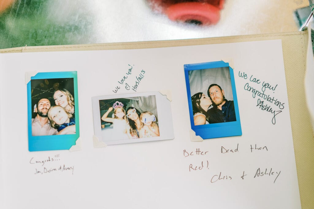 Polaroid guest book at a wedding with photos of guests.
