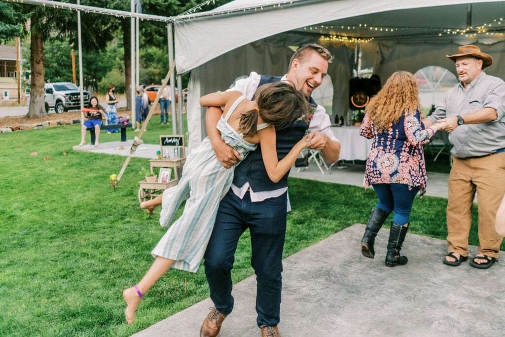 Groom dancing with his niece at a wedding in Ouray.