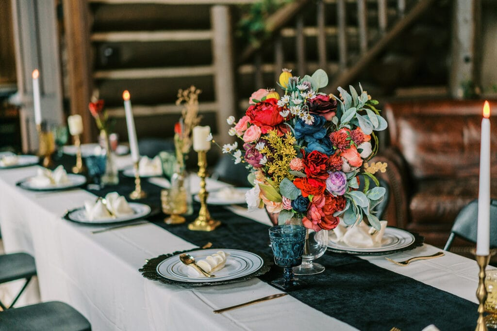 Elopement reception with a colorful decorated table ready for dinner