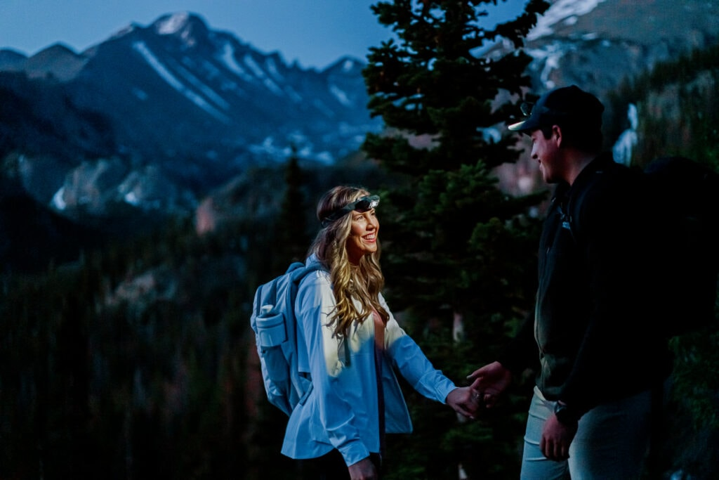 Couple out hiking before sunrise in Rocky Mountain National Park.