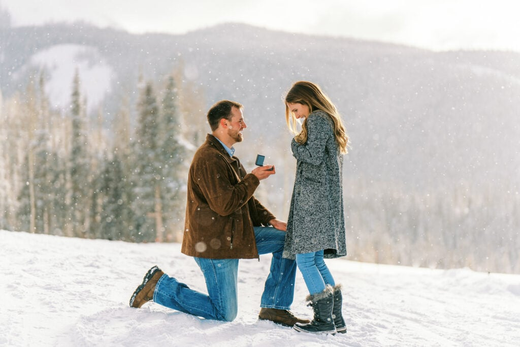 Photography of a Telluride, Colorado surprise proposal on a snowy mountain top.