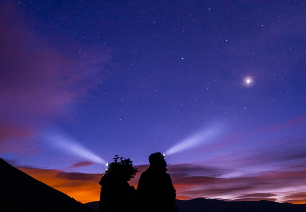 Bride and groom with head lamps during an elopement in Breckenridge, Colorado.