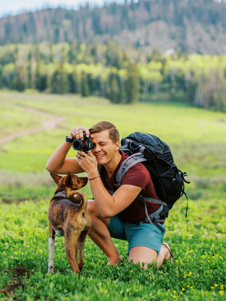 Malachi Lewis, a photographer in Colorado with his dog.